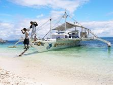 Philippines Scuba Diving Holiday. Malapascua Dive Boat Unloading.