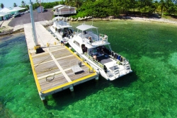 Cayman Brac Beach Resort - Cayman Islands. Dive boat jetty.