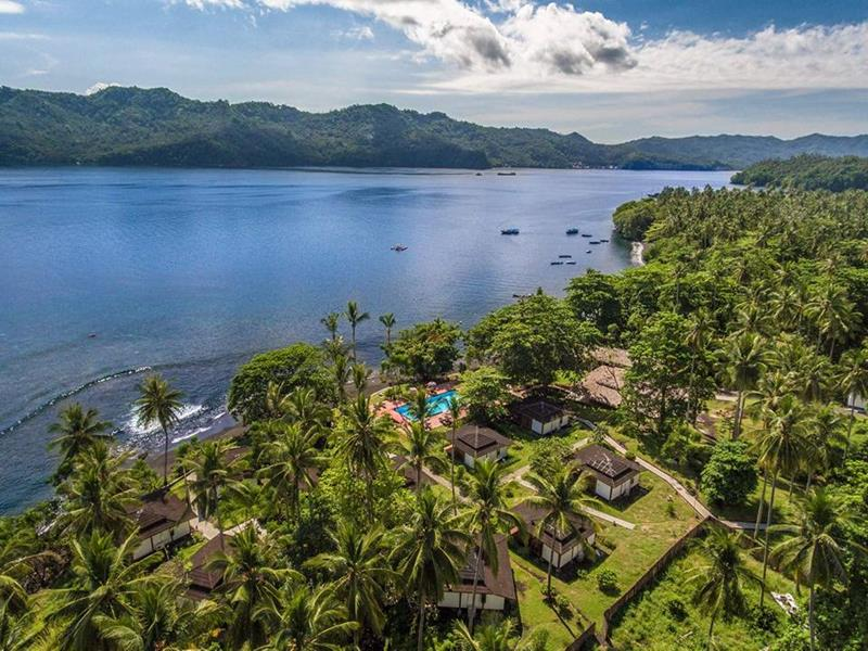 Dive into Lembeh at Hairball Resort - divers hotel. Aerial view.